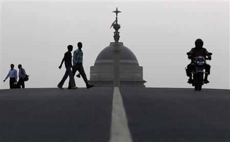 People walk in front of India's presidential palace Rashtrapati Bhavan