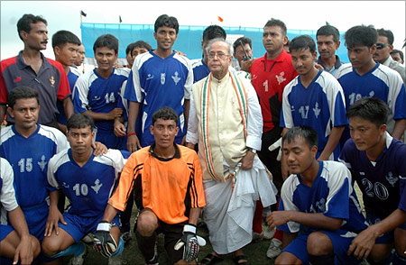 Pranab Mukherjee with a football team.