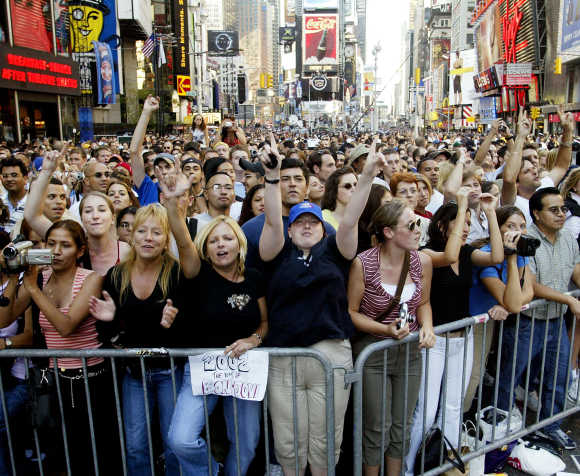 Thousands of people gather in Times Square to celebrate the opening day of NFL season in New York.