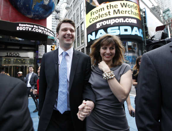 Groupon CEO Andrew Mason walks with his wife Jenny Gillespie outside the Nasdaq in New York.