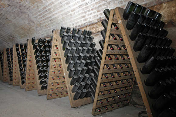 Bottles of champagne are stacked in the Maison Moet et Chandon underground galleries in Epernay, France.