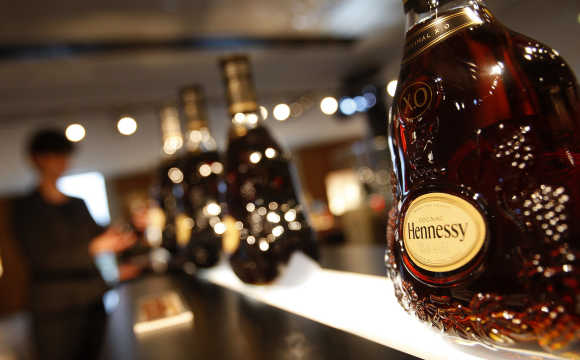 A customer looks at bottles of Hennessy X.O at the Hennessy factory in Cognac, southwestern France.