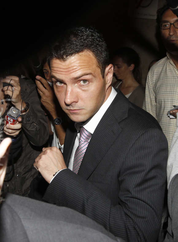 Former trader Kerviel arrives at Paris court for the start of his trial to face charges of breach of trust, computer abuse and forgery.