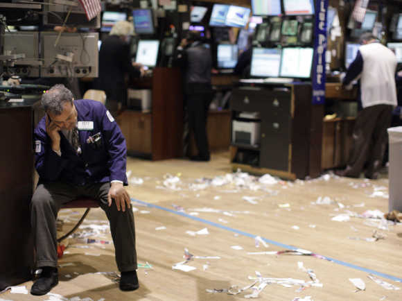 A trader reacts on the floor of the New York Stock Exchange.