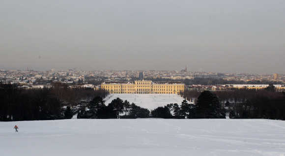 The evening sun illuminates Schoenbrunn palace in Vienna.