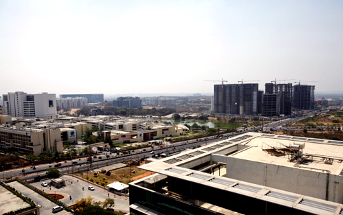 An elevated view shows a newly-built highway and the Gachibowli district in Hyderabad, which is home to many of Hyderabad's IT campuses.