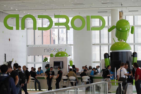 Attendees gather at the Android developer sandbox during the Google I/O Conference in San Francisco.