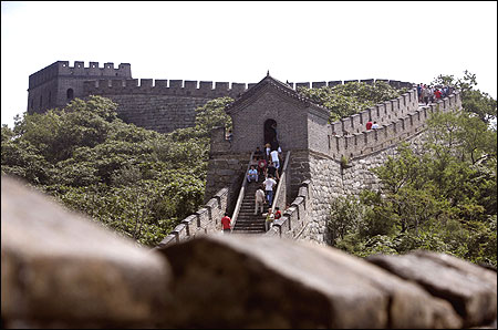 Tourists walk along the Mutianyu section of the Great Wall in Huairou District, Beijing.