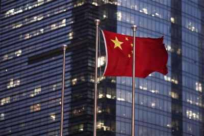 China lowers its GDP target for first time in 7 years