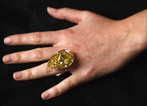 A model displays the Sun-Drop diamond during a media preview in Geneva.