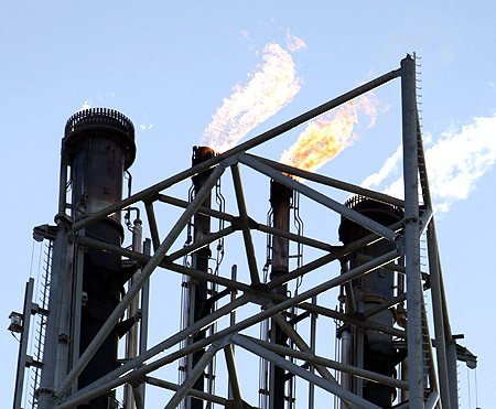 Flames come out of chimneys at Repsol's oil refinery in Cartagena, eastern Spain.