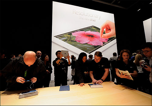 Members of the media preview the new iPad.