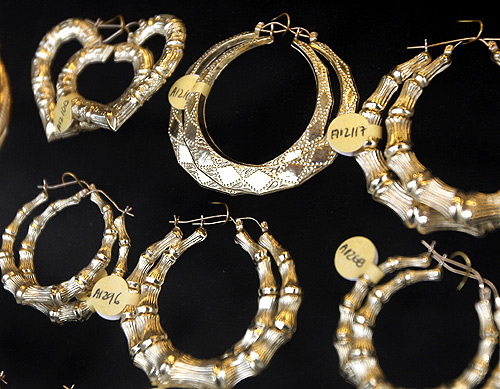 Gold earrings are seen on display at a store in New York.