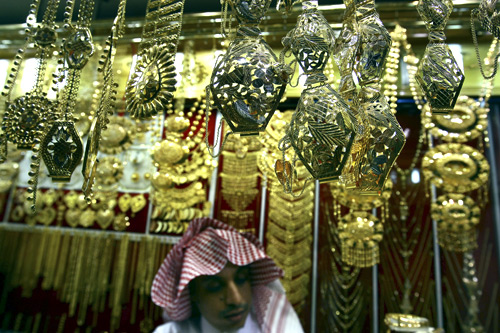 A salesman arranges gold necklaces at a jewellery shop in downtown Riyadh.