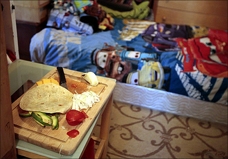 Eight-year-old Dylan Burger's bedroom doubles as a kitchen in a converted garage in Los Angeles, California.