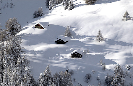 Chalets are pictured after a snow fall on a winter day at the Vallee de la Sionne in Anzere near Sion.