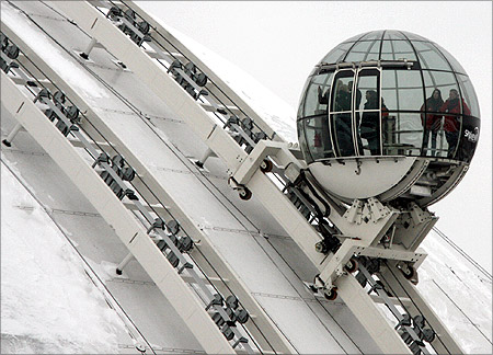 A glass gondola carries visitors to the top of the Ericsson Globe Arena 130 meters (427 feet) above sea level during a press preview of the Globen SkyView in Stockholm.