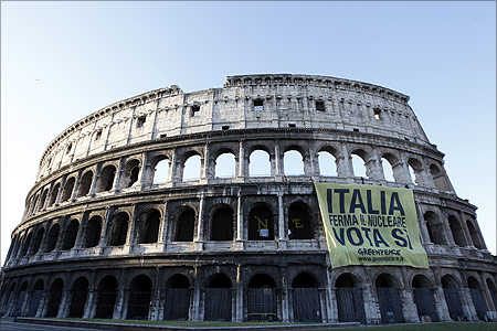 Members of environmental activist group Greenpeace unfurl a banner from Rome's ancient Colosseum.