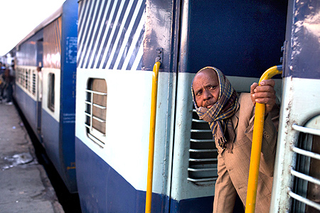 A man peers from a carriage prior to departure from the Nizamuddin Railway Station.