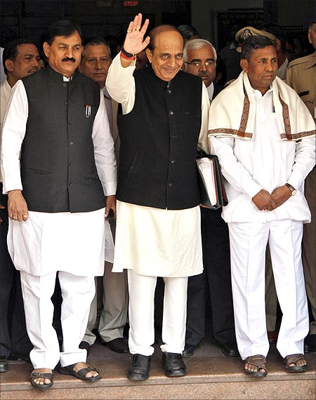 Railways Minister Dinesh Trivedi (C) waves as he leaves his office to present the Railway Budget.