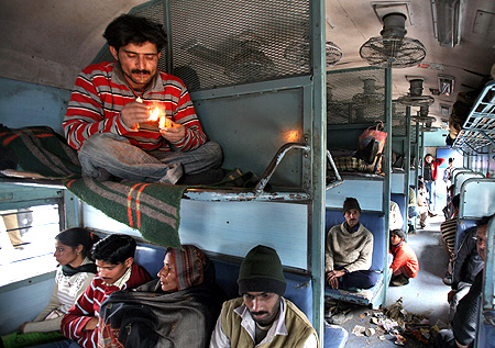 A commuter smokes inside a passenger train in Jammu.