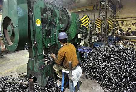 Men work inside a steel factory at Ludhiana in Punjab.