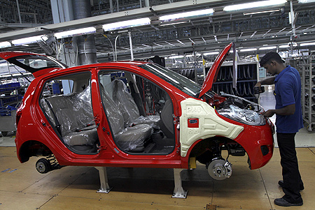 A worker assembles a Hyundai i10 car at a plant of Hyundai Motor India in Sriperumbudur.