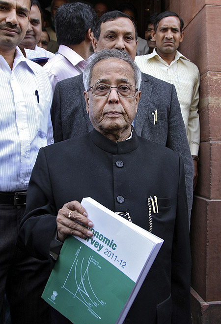 Finance Minister Pranab Mukherjee comes out of the parliament after presenting the 2011-2012 economic survey report in New Delhi.