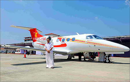 Kalyanaraman in front of the Embraer jet.