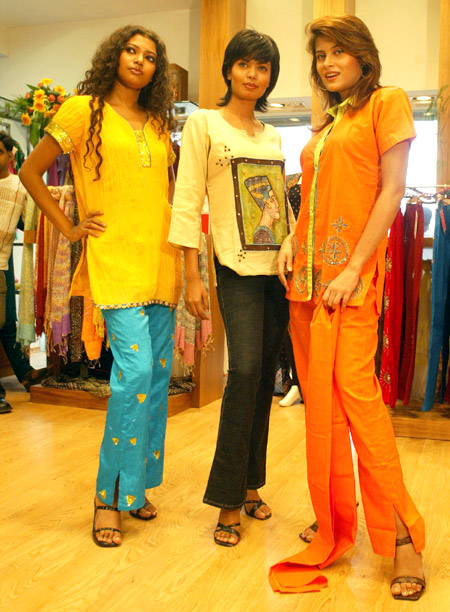 Models display new dresses during the opening of a new fashion botique for women in Kolkata.