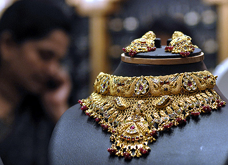 A woman speaks on a phone inside a jewellery shop in Hyderabad.