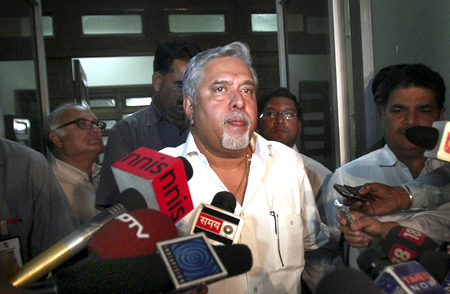 Kingfisher Airlines Chairman Vijay Mallya speaks with the media after his meeting with Director General of Civil Aviation E.K. Bharat Bhushan in New Delhi