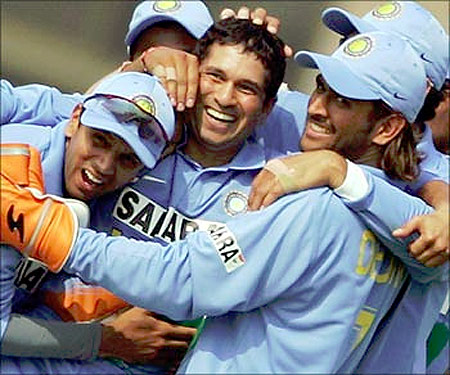 Sachin Tendulkar celebrates with team mates.
