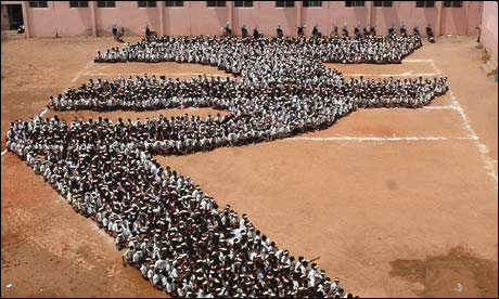 Students form the symbol of the rupee.