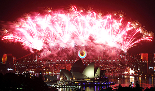 Fireworks explode over the Sydney Harbour Bridge and Opera House during a pyrotechnic show