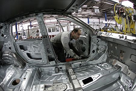 An employee works on an assembly line at a Fiat factory in the central Serbian town of Kragujevac.