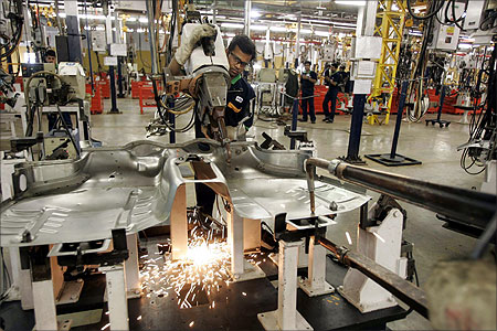 Employees work in the Fiat factory at Ranjangaon.