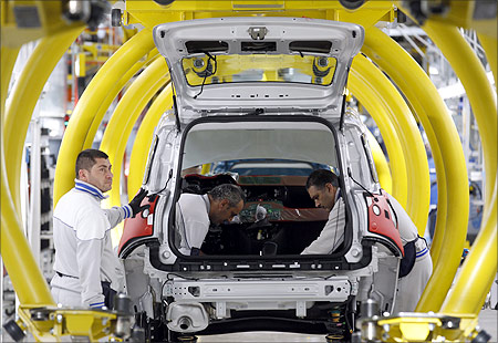Employees of Fiat SpA work on new car