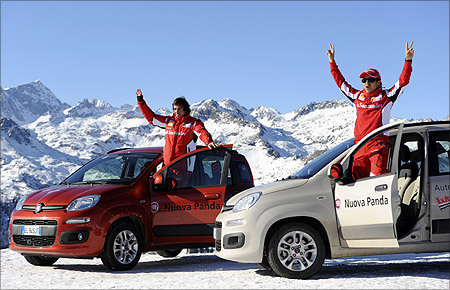 Ferrari's Formula One drivers Felipe Massa (R) of Brasil and Fernando Alonso of Spain pose on new Fiat Panda cars during the
