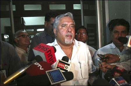 Kingfisher chairman Vijay Mallya speaks with the media after his meeting with Director General of Civil Aviation E K Bharat Bhushan.