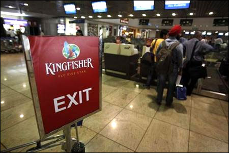 Kingfisher Airlines customers wait in a check-in queue at Mumbai's domestic airport.