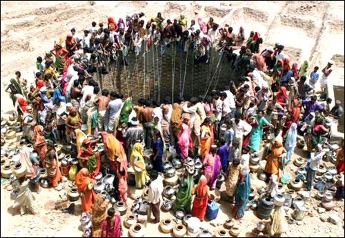 People gather to get water from a huge well in the village of Natwarghad in Gujarat.