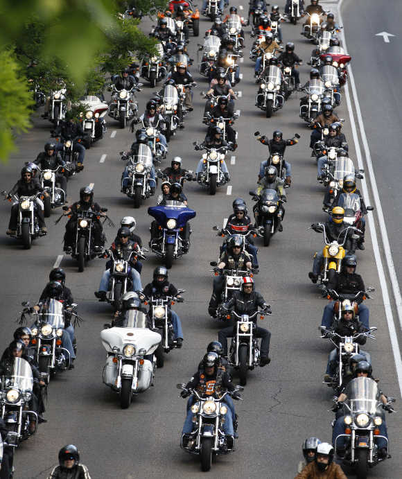 Motorcyclists ride down a central avenue during the ninth annual Harley Davidson owners get-together in Madrid.