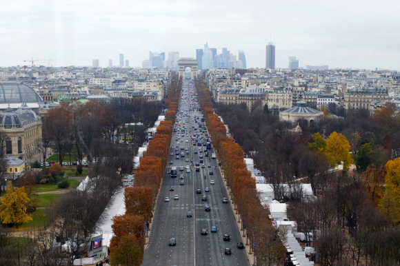 A general view, taken from a closed gondola, shows the Champs Elysees Avenue and the Arc de Triomphe monument in Paris.