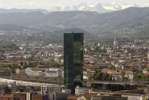 A view of the Prime Tower office building in Zurich in front of the eastern Swiss Alps.
