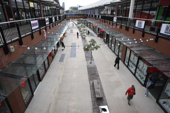 Shoppers walk through a new complex in Melbourne.