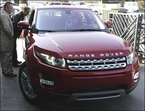 Customers look at a Range Rover Evoque.
