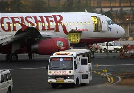 A bomb squad vehicle stands next to a Kingfisher flight at Chattrapati Shivaji airport in Mumbai.
