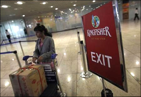 A lone Kingfisher Airlines customer waits in a check-in queue at Mumbai's domestic airport.