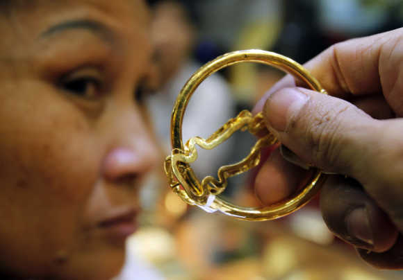 A woman waits to sell gold at a shop in Hanoi.